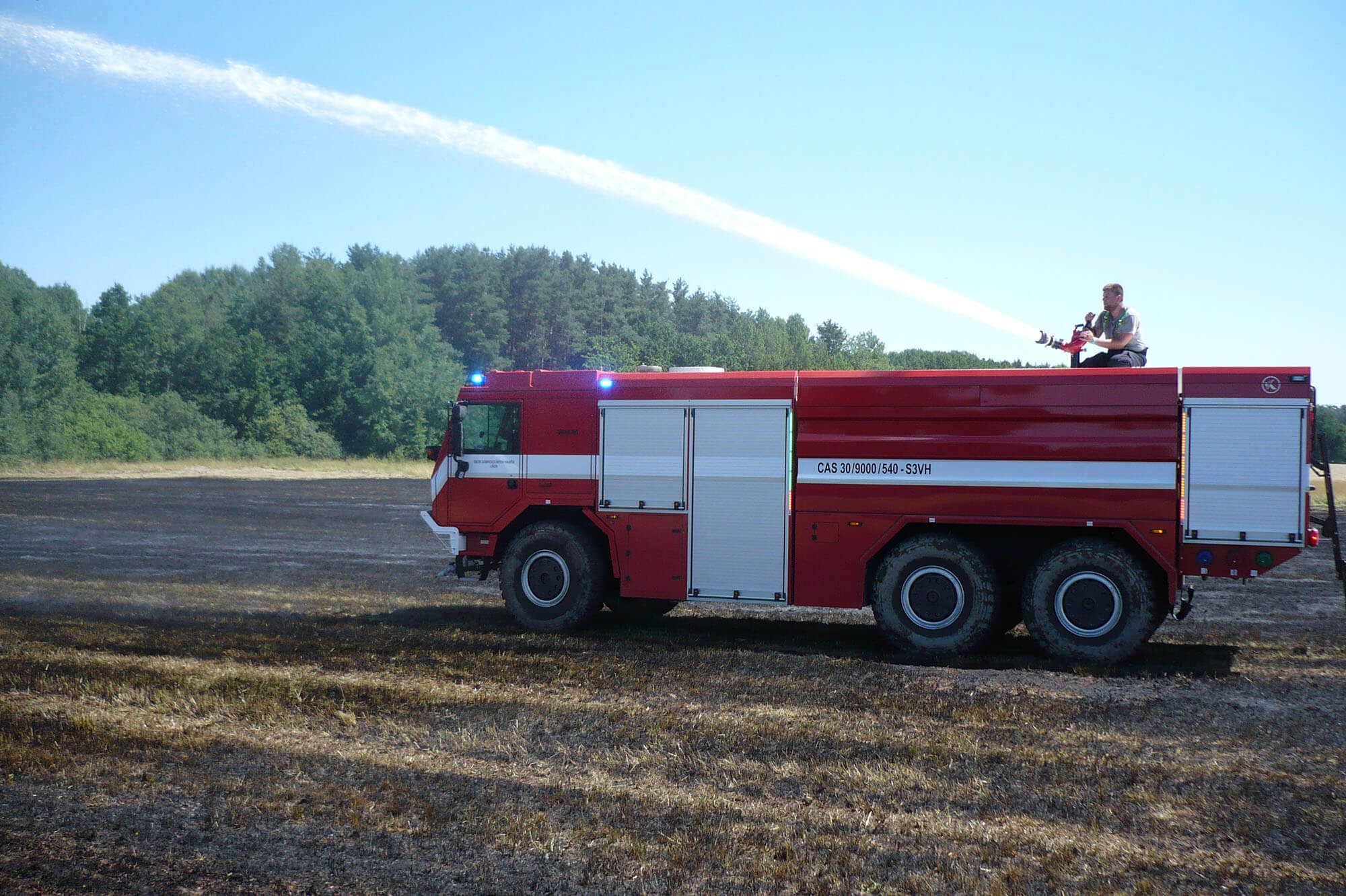 Požár pole ve Slověnicích